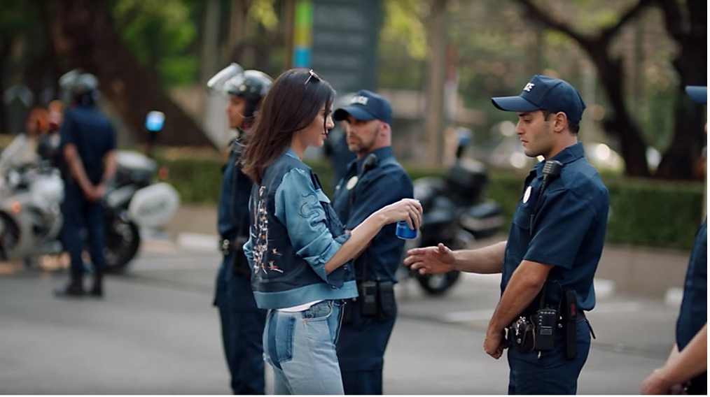 kendal jenner giving riot police a can of pepsi - controversial marketing campaign